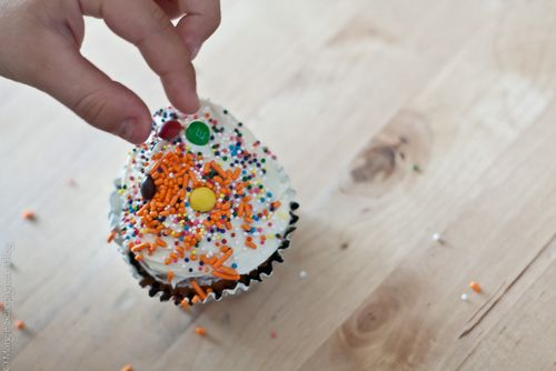 Decorate your own cupcakes with mini M&Ms and sprinkles