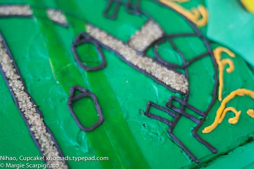 xnomads.typepad.com Lego Ninjago Mini Fig Cake tutorial metallic sugar detail